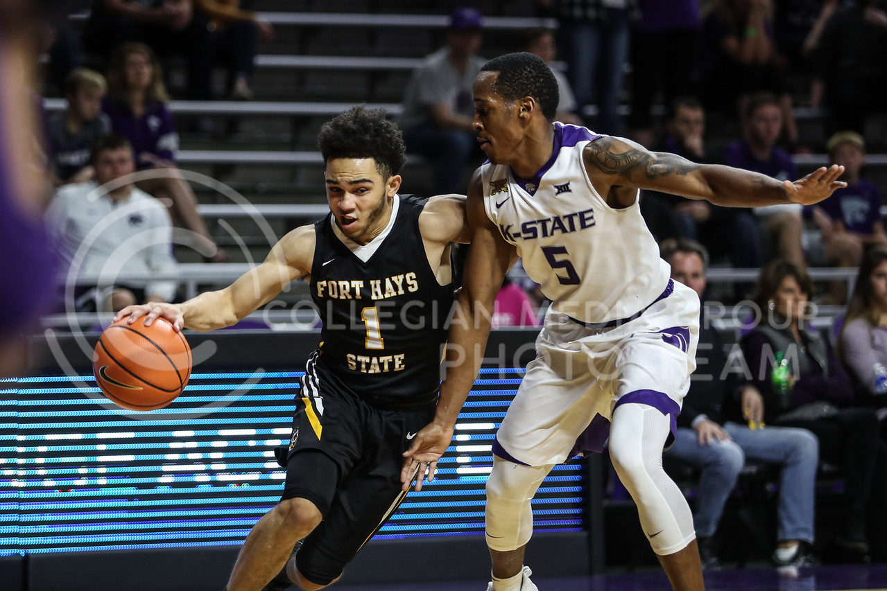 MANHATTAN, KANSAS - OCTOBER 29: Fort Hays #1 Aaron Nicholson runs by Kansas State #5 Barry Brown during the men's basketball game between Fort Hays State University and Kansas State University at Bramlage Coliseum on October 29, 2017. (Photo by Cooper Kinley | K-State Athletics)