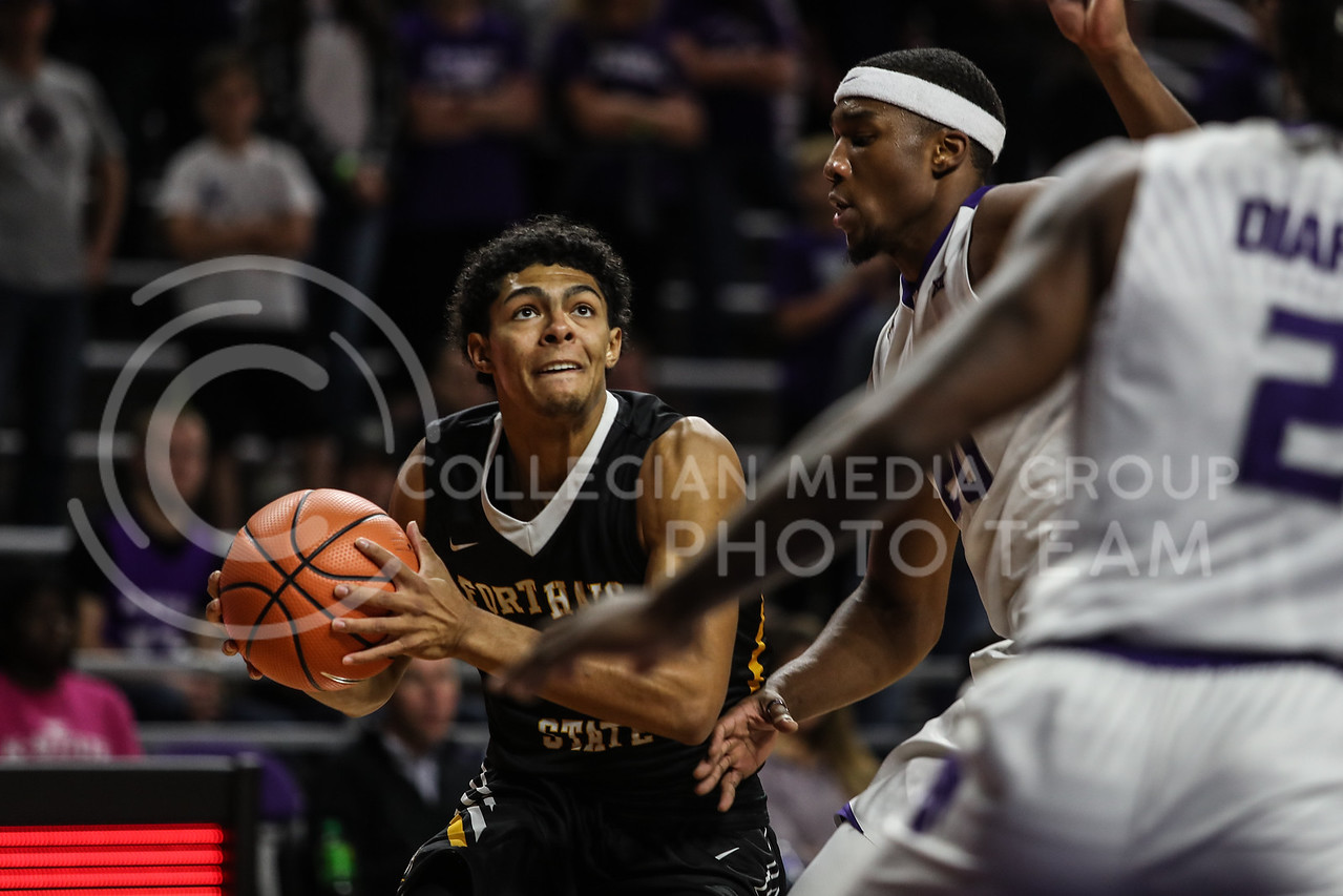MANHATTAN, KANSAS - OCTOBER 29: Fort Hays #0 Keshawn Wilson eyes the basketball hoop ball during the men's basketball game between Fort Hays State University and Kansas State University at Bramlage Coliseum on October 29, 2017. (Photo by Cooper Kinley | K-State Athletics)