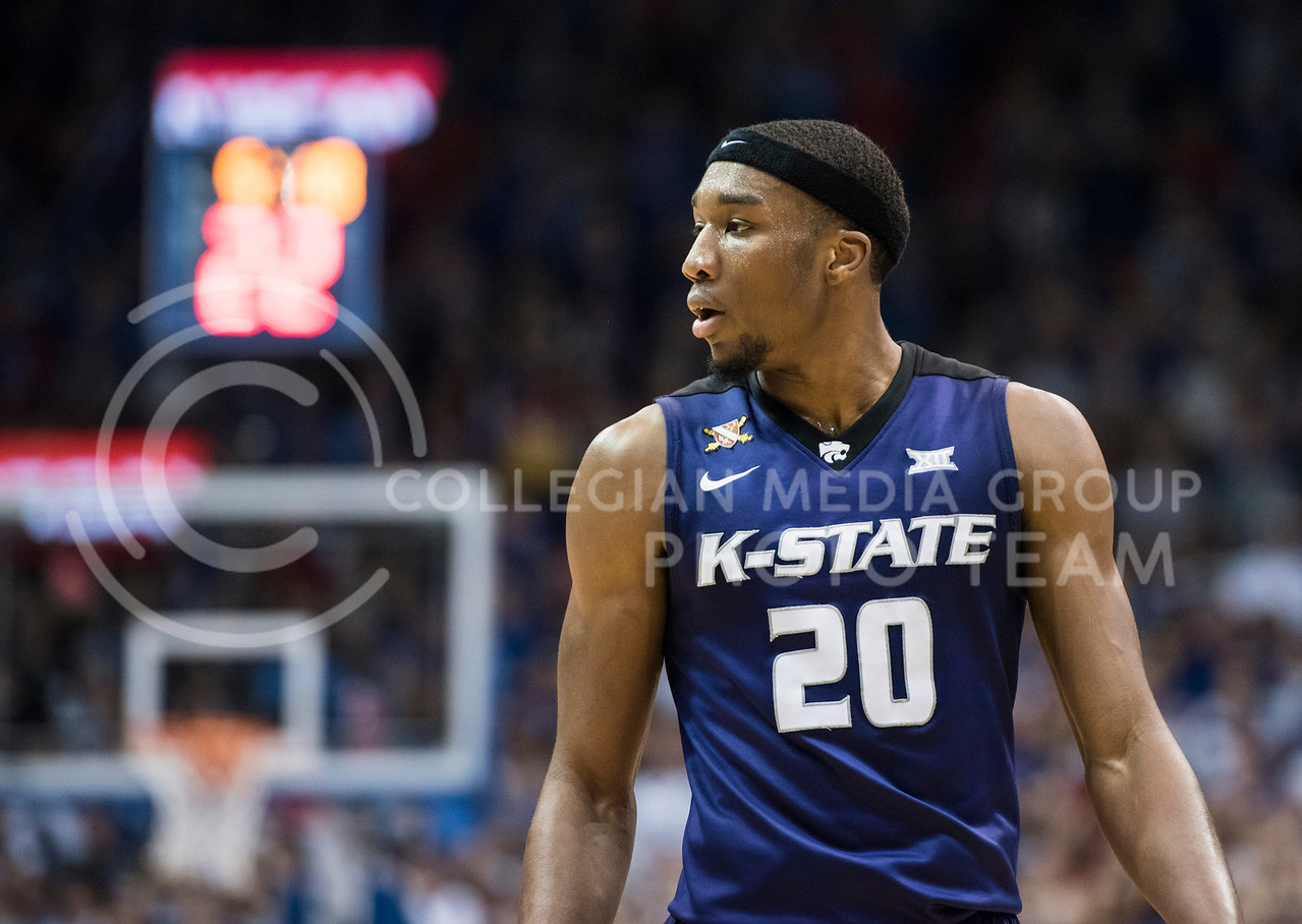 Kansas State Wildcat number 20, Xavier Sneed, prepares for the next play during the basketball game against the Kansas Jayhawks at the Allen Fieldhouse, in Lawrence, Kan. on Jan. 13, 2018. (Olivia Bergmeier | Collegian Media Group)