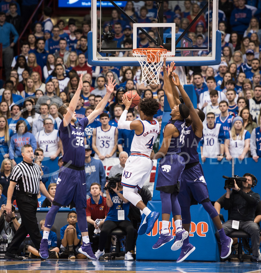 Kansas State Wildcats defend against Kansas Jayhawk number 4, Devonte' Grahm, at Allen Fieldhouse in Lawrence, Kan. on Jan. 13, 2018. (Olivia Bergmeier | Collegian Media Group)