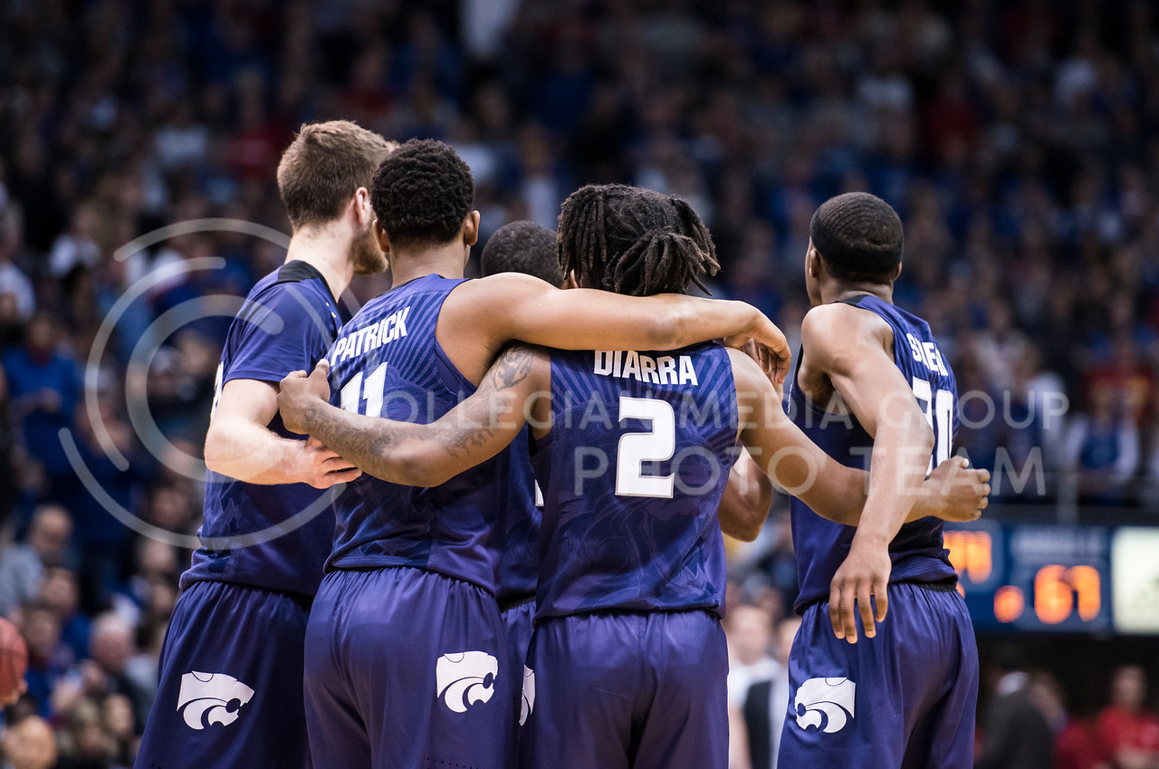 The Kansas State Wildcats huddle before the next play against the Kansas Jayhawks at Allen Fieldhouse in Lawrence, Kan., on Jan. 13, 2018. (Olivia Bergmeier | Collegian Media Group)