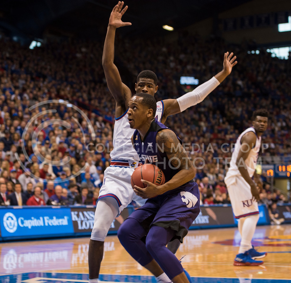 Kansas State Wildcat number 5, Barry Brown Jr., charges past Kansas Jayhawk number 14, Malik Newman, during the Sunflower Showdown at Allen Fieldhouse in Lawrence, Kan., on Jan. 13, 2018.