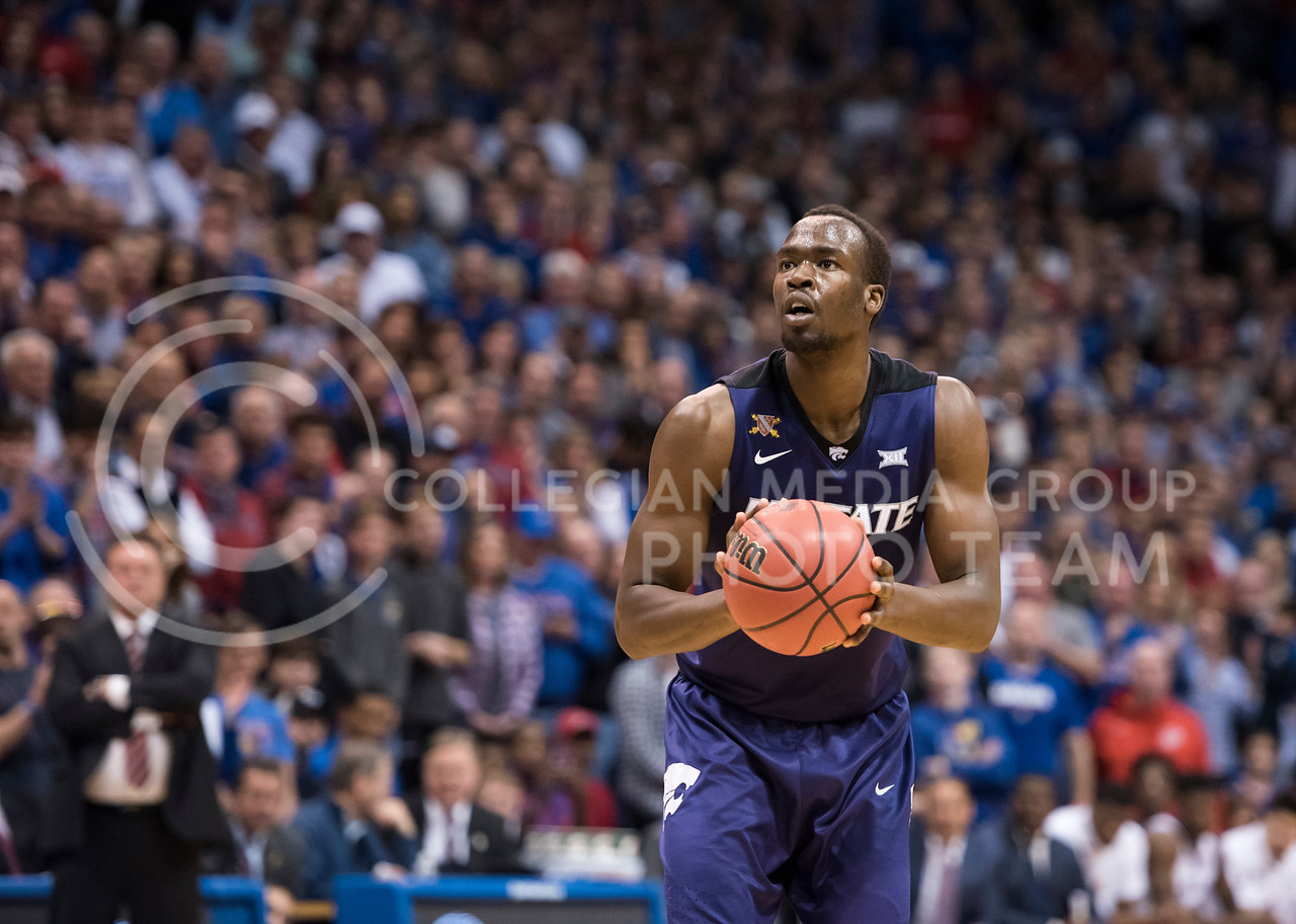 Kansas State Wildcat number 14, Makol Mawien, readies his shot against the Kansas Jayhawks at Allen Fieldhouse in Lawrence, Kan., on Jan. 13, 2018. (Olivia Bergmeier | Collegian Media Group)