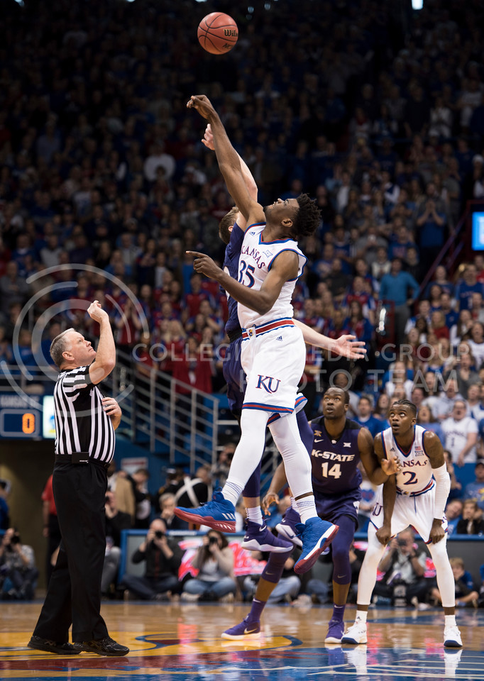 Kansas State Wildcat number 32 Dean Wade competes against Kansas Jayhawk number 35 Udoka Azubuike during the tip off at Allen Fieldhouse in Lawrence, Kan. on Jan. 13, 2018. (Olivia Bergmeier | Collegian Media Group)