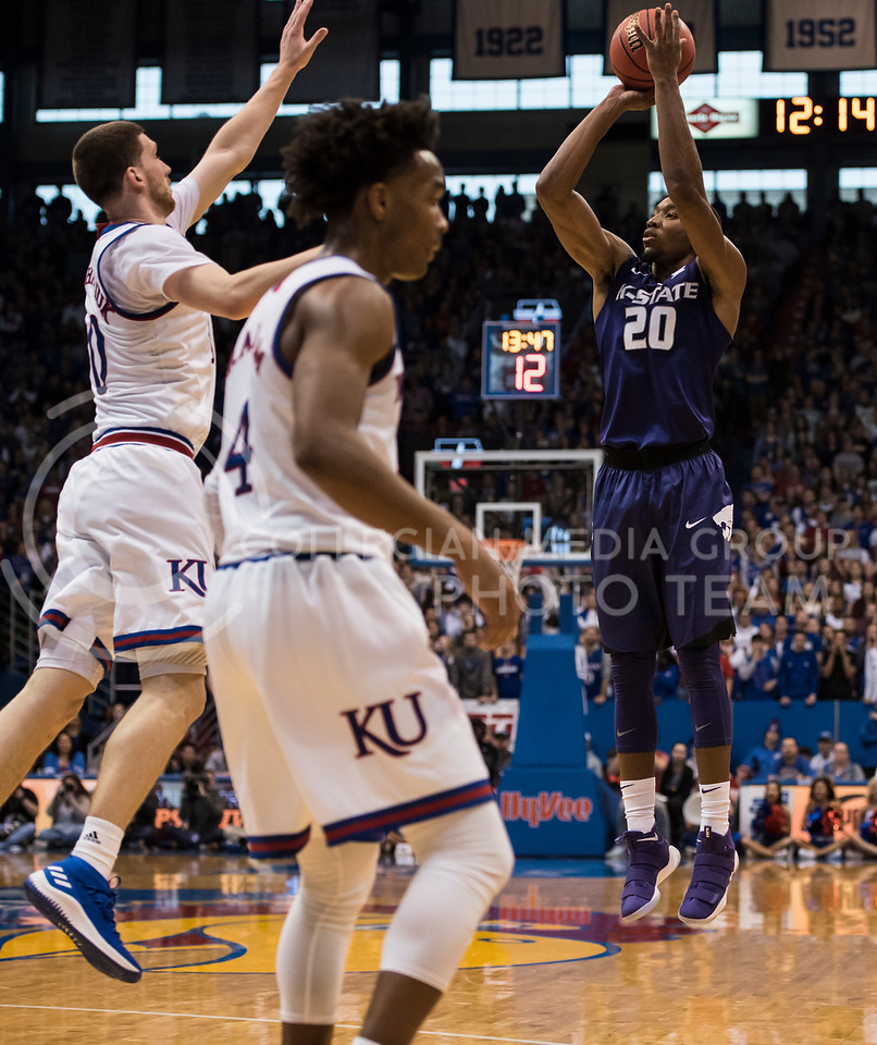 Kansas State Wildcat number 20, Xavier Sneed, shoots for 3 against the Kansas Jayhawks at Allen Fieldhouse in Lawrence, Kan., on Jan. 13, 2018. (Olivia Bergmeier | Collegian Media Group)