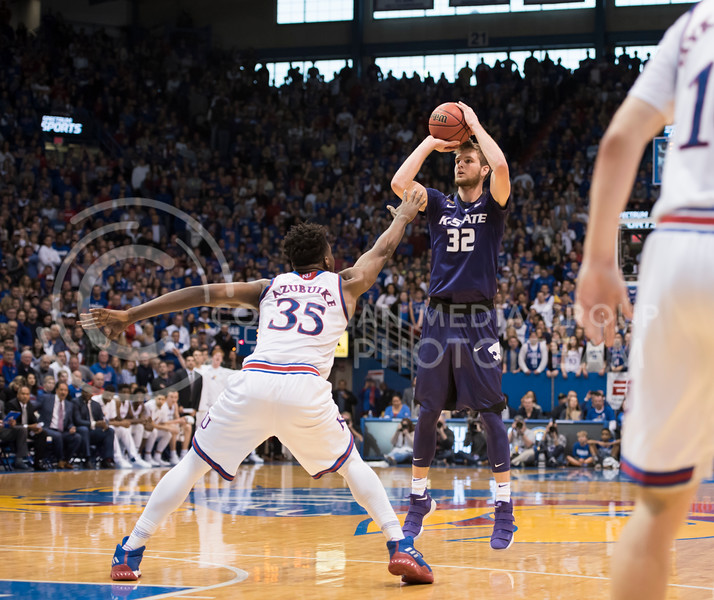 Kansas State Wildcat number 32, Dean Wade, takes a shot during the basket ball game against the Kansas Jayhawks at Allen Fieldhouse in Lawrence, Kan., on Jan. 13, 2018. (Olivia Bergmeier | Collegian Media Group)