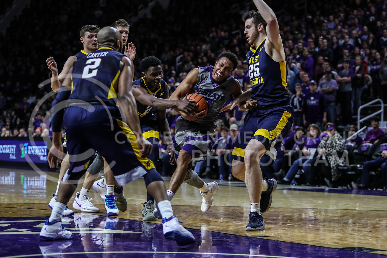 The Men's Basketball teams of The University of West Virginia and Kansas State University face off at Bramlage Coliseum in Manhattan, Kansas, on January 1, 2018. (Photo by Cooper Kinley | K-State Athletics / Collegian Media Group)