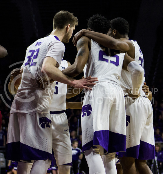 Kansas State mens basketball team huddles up for a quick talk at the game against Iowa State on Feb. 15, 2017 at Bramlage Coliseum. (Kelly Pham | The Collegian)