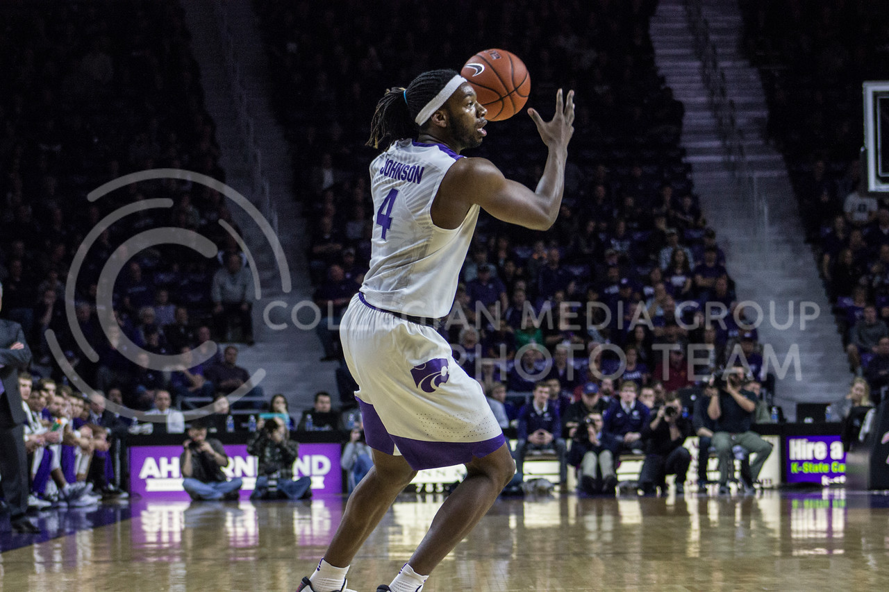 Forward DJ Johnson tries to figure out his next move at the game against Iowa State on Feb. 15, 2017 at Bramlage Coliseum. (Kelly Pham | The Collegian)