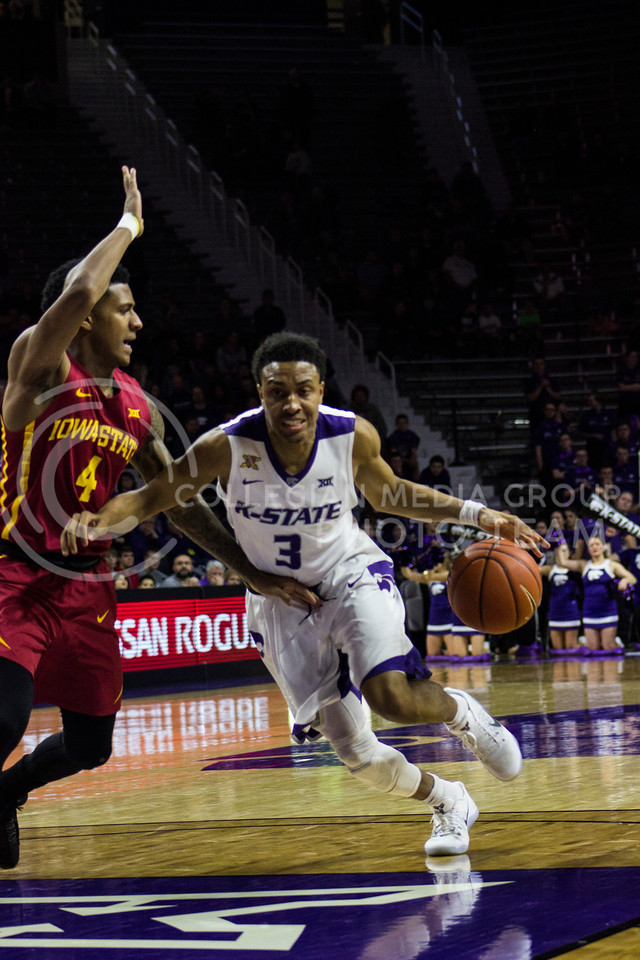Guard Kamau Stokes charges for the goal at the game against Iowa on Feb. 15, 2017 at Bramlage Coliseum. (Kelly Pham | The Collegian)