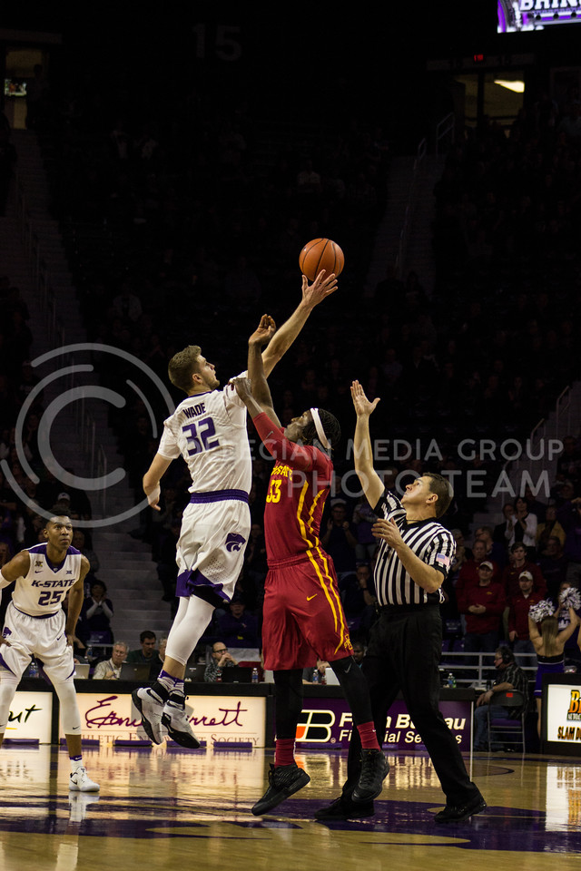 Forward Dean Wade jumps for the ball at the game against Iowa State on Feb. 15, 2017 at Bramlage Coliseum. (Kelly Pham | The Collegian)
