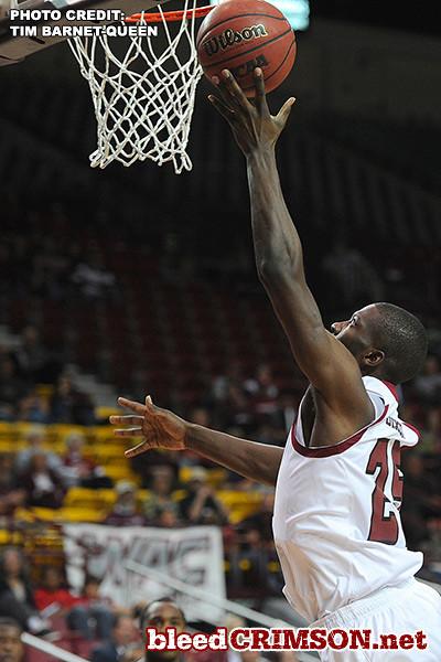 Renaldo Dixon (25) puts up a shot