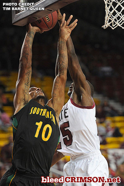 Renaldo Dixon (25) blocks a shot
