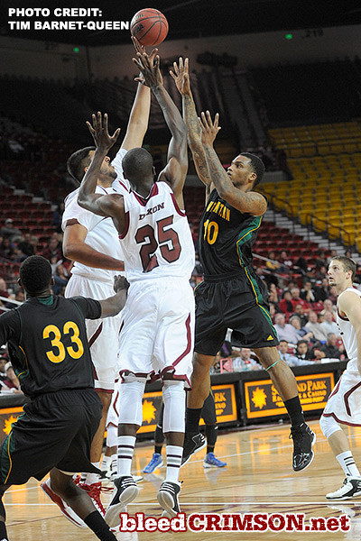 Sim Bhullar (2) blocks a shot, Renaldo Dixon (25) also goes up to defend.
