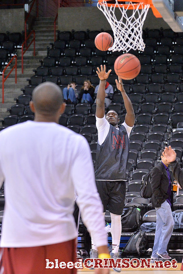 March 19, 2014: Tshilidzi Nephawe takes a jump shot as the New Mexico State men's basketball team prepares for their second round game versus 4-seed San Diego State.