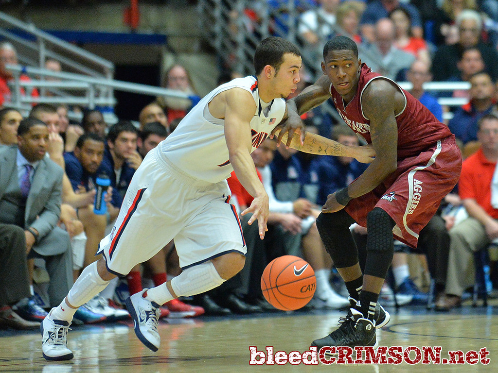 December 11, 2013: New Mexico State Aggies guard DK Eldridge (1) guards Arizona Wildcats guard Gabe York (1) in the second half in a game between No. 1 Arizona and New Mexico State at McKale Center in Tucson, Ariz. Arizona defeated New Mexico State 74-48.