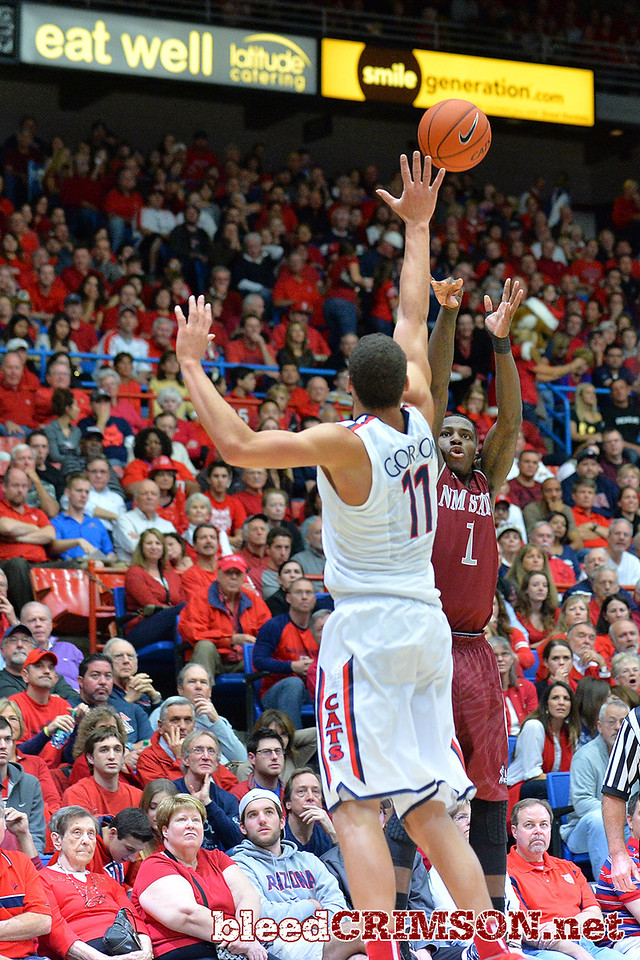 December 11, 2013: New Mexico State Aggies guard DK Eldridge (1) takes a shot over Arizona Wildcats forward Aaron Gordon (11) in the first half in a game between No. 1 Arizona and New Mexico State at McKale Center in Tucson, Ariz. Arizona defeated New Mexico State 74-48.