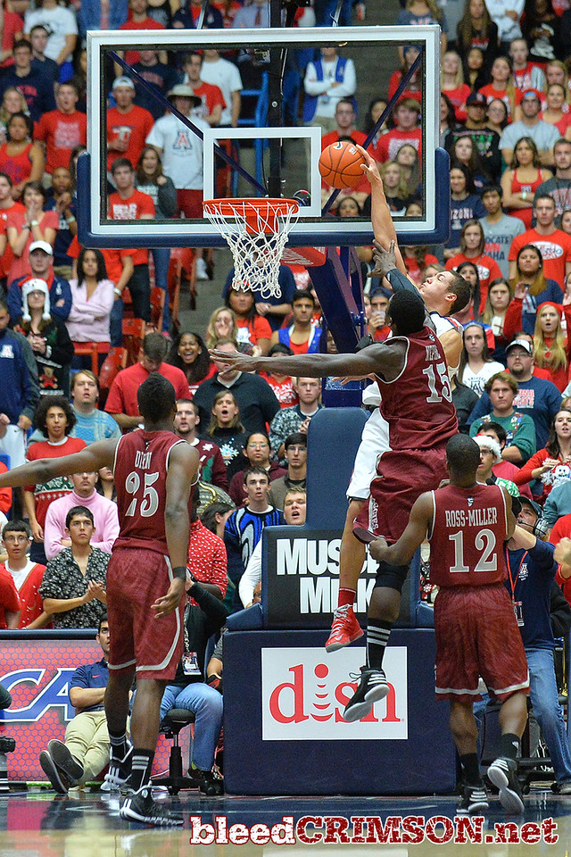 December 11, 2013: New Mexico State Aggies center Tshilidzi Nephawe (15) contests a dunk attempt by Arizona Wildcats forward Aaron Gordon (11) in a game between No. 1 Arizona and New Mexico State at McKale Center in Tucson, Ariz. Arizona defeated New Mexico State 74-48.