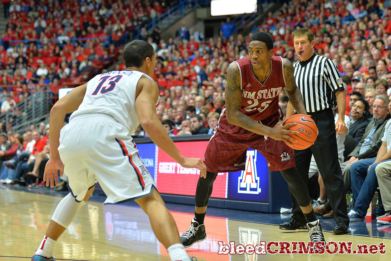 December 11, 2013: New Mexico State Aggies guard Daniel Mullings (23) looks to drive to the basket in a game between No. 1 Arizona and New Mexico State at McKale Center in Tucson, Ariz. Arizona defeated New Mexico State 74-48.