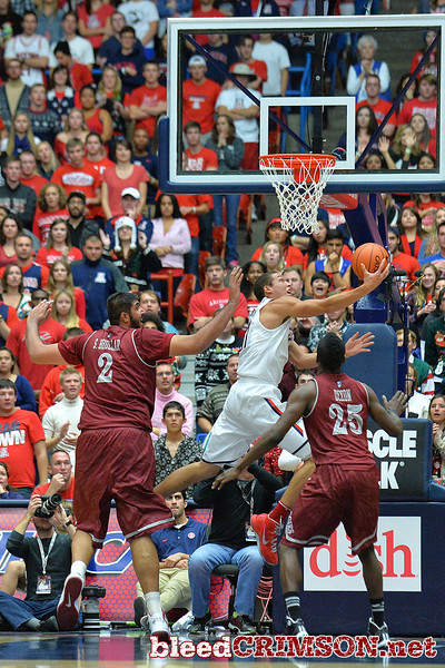 December 11, 2013: Arizona Wildcats forward Aaron Gordon (11) gets past the Aggie defenders for a reverse layup in the first half in a game between No. 1 Arizona and New Mexico State at McKale Center in Tucson, Ariz. Arizona defeated New Mexico State 74-48.
