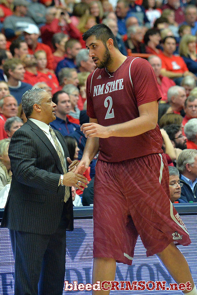 December 11, 2013: New Mexico State Aggies head coach Marvin Menzies greets New Mexico State Aggies center Sim Bhullar (2) as he comes to the bench in a game between No. 1 Arizona and New Mexico State at McKale Center in Tucson, Ariz. Arizona defeated New Mexico State 74-48.