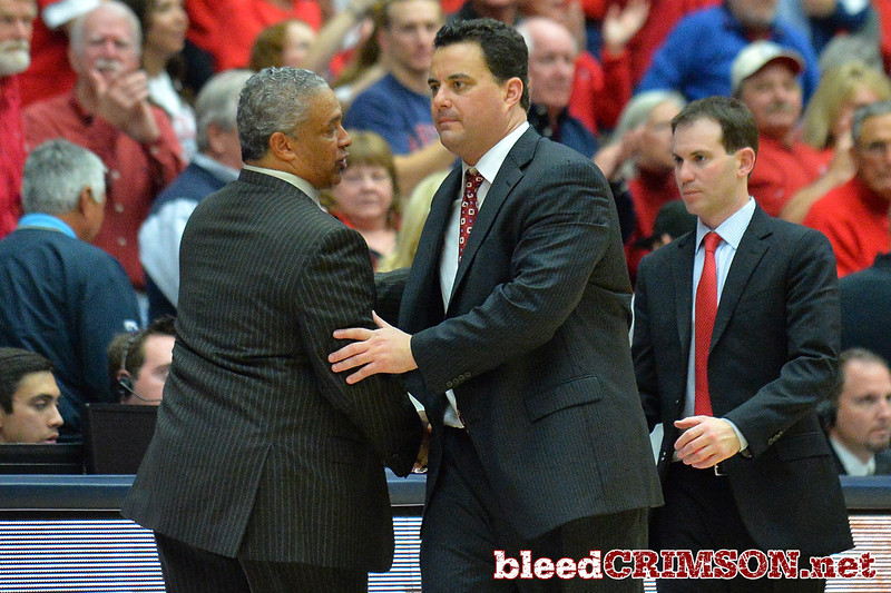 December 11, 2013: New Mexico State Aggies head coach Marvin Menzies and Arizona Wildcats head coach Sean Miller shake hands after a game between No. 1 Arizona and New Mexico State at McKale Center in Tucson, Ariz. Arizona defeated New Mexico State 74-48.