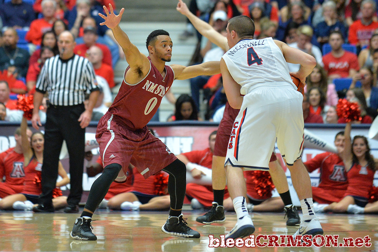 December 11, 2013: New Mexico State Aggies guard Travon Landry (0) guards Arizona Wildcats guard T.J. McConnell (4) in a game between No. 1 Arizona and New Mexico State at McKale Center in Tucson, Ariz. Arizona defeated New Mexico State 74-48.