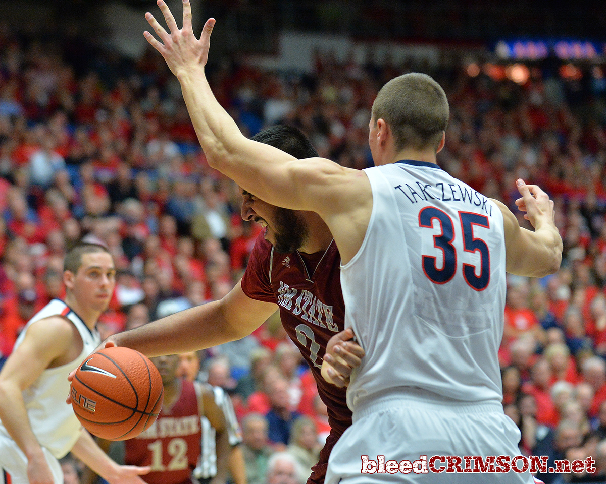December 11, 2013: New Mexico State Aggies center Sim Bhullar (2) battles for position in the paint against Arizona Wildcats center Kaleb Tarczewski (35) in a game between No. 1 Arizona and New Mexico State at McKale Center in Tucson, Ariz. Arizona defeated New Mexico State 74-48.
