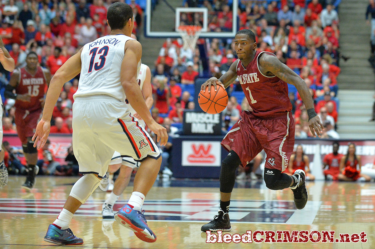 December 11, 2013: New Mexico State Aggies guard DK Eldridge (1) brings the ball up the court in the second half in a game between No. 1 Arizona and New Mexico State at McKale Center in Tucson, Ariz. Arizona defeated New Mexico State 74-48.