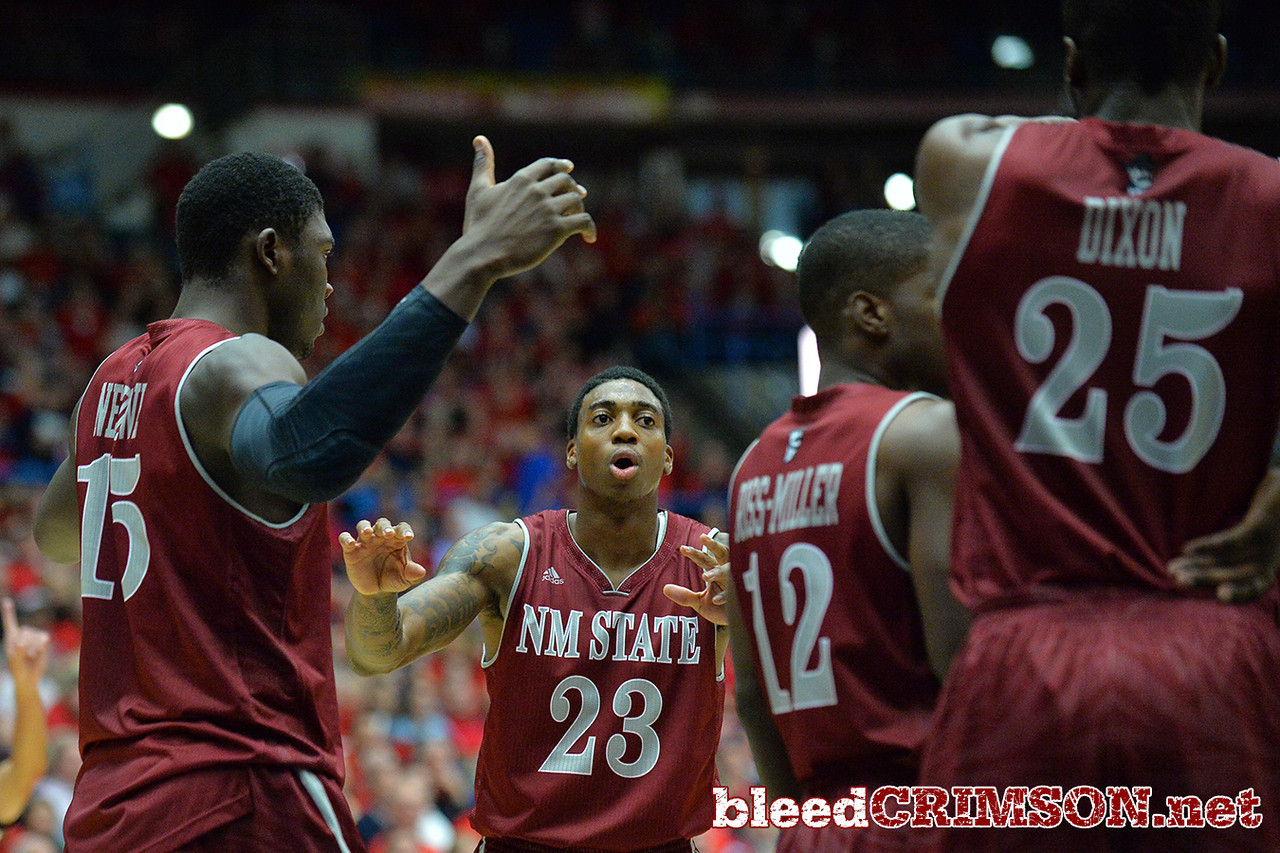 December 11, 2013: New Mexico State Aggies guard Daniel Mullings (23) talks to his teammates during a timeout in a game between No. 1 Arizona and New Mexico State at McKale Center in Tucson, Ariz. Arizona defeated New Mexico State 74-48.