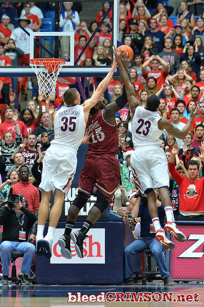 December 11, 2013: New Mexico State Aggies center Tshilidzi Nephawe (15) battles for a rebound against Arizona Wildcats center Kaleb Tarczewski (35) and Arizona Wildcats forward Rondae Hollis-Jefferson (23) in a game between No. 1 Arizona and New Mexico State at McKale Center in Tucson, Ariz. Arizona defeated New Mexico State 74-48.