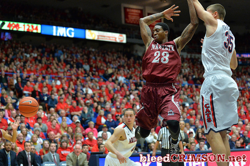 December 11, 2013: New Mexico State Aggies guard Daniel Mullings (23) loses the ball on the way to the basket in a game between No. 1 Arizona and New Mexico State at McKale Center in Tucson, Ariz. Arizona defeated New Mexico State 74-48.
