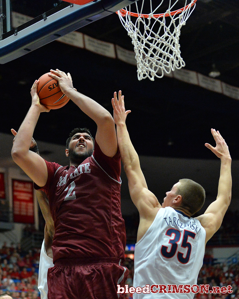 December 11, 2013: New Mexico State Aggies center Sim Bhullar (2) puts up a shot over Arizona Wildcats center Kaleb Tarczewski (35) in a game between No. 1 Arizona and New Mexico State at McKale Center in Tucson, Ariz. Arizona defeated New Mexico State 74-48.