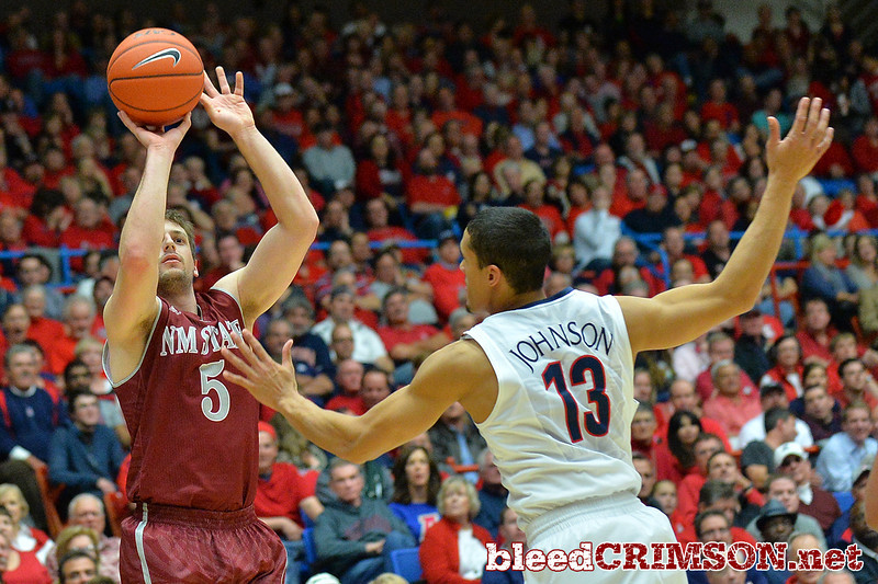 December 11, 2013: New Mexico State Aggies guard Kevin Aronis (5) shoots a three pointer in a game between No. 1 Arizona and New Mexico State at McKale Center in Tucson, Ariz. Arizona defeated New Mexico State 74-48.