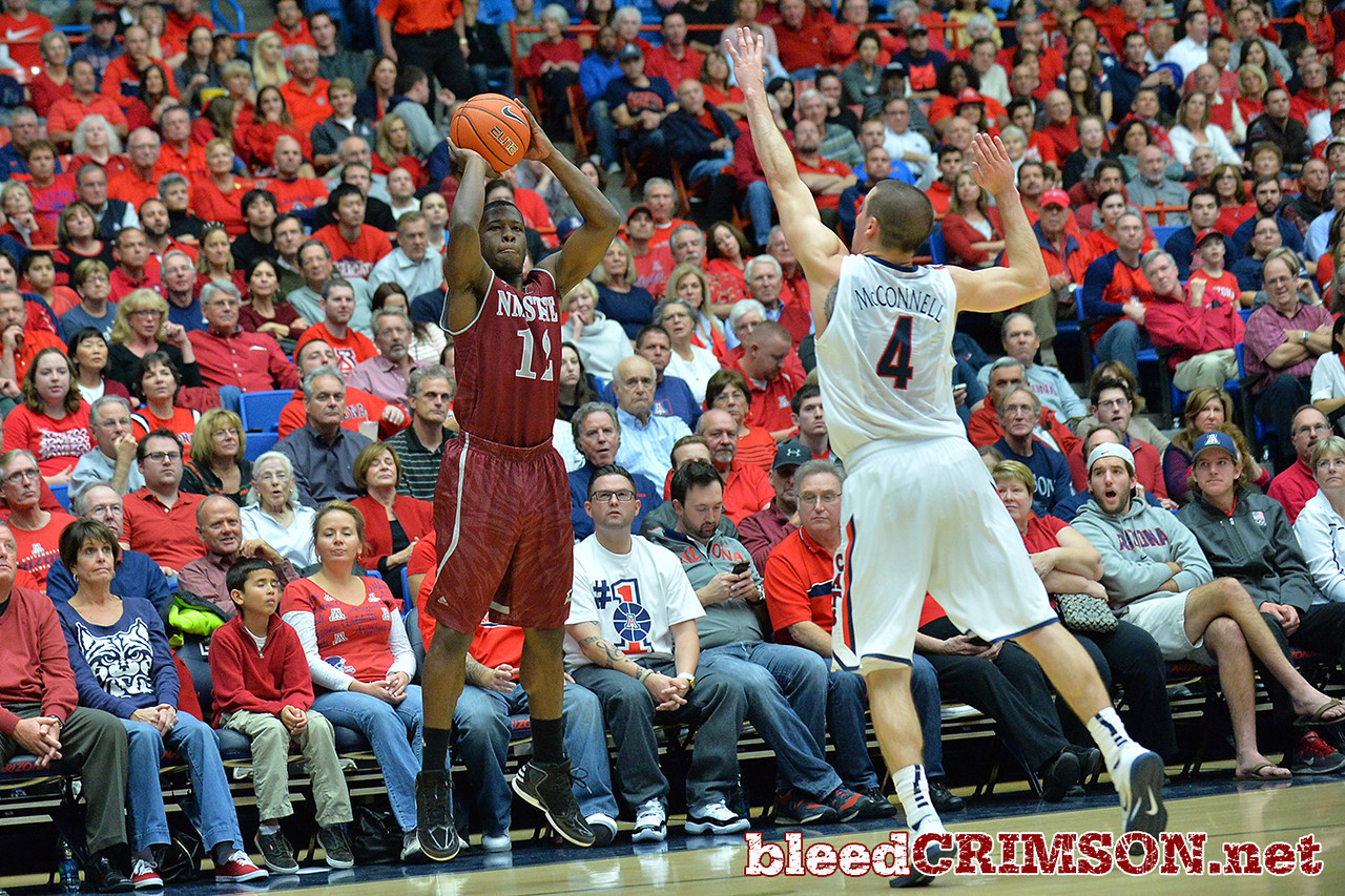 December 11, 2013: New Mexico State Aggies guard K.C. Ross-Miller (12) shoots a three pointer in the first half in a game between No. 1 Arizona and New Mexico State at McKale Center in Tucson, Ariz. Arizona defeated New Mexico State 74-48.