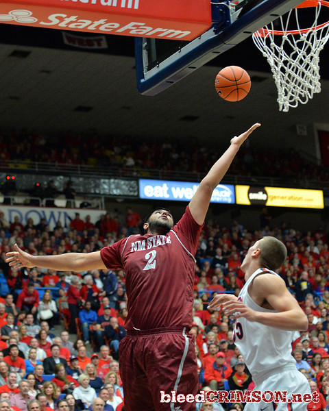 December 11, 2013: New Mexico State Aggies center Sim Bhullar (2) stretches for a rebound in a game between No. 1 Arizona and New Mexico State at McKale Center in Tucson, Ariz. Arizona defeated New Mexico State 74-48.