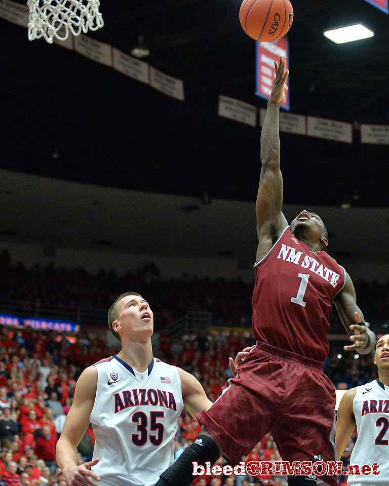 December 11, 2013: New Mexico State Aggies guard DK Eldridge (1) puts up a shot in a game between No. 1 Arizona and New Mexico State at McKale Center in Tucson, Ariz. Arizona defeated New Mexico State 74-48.