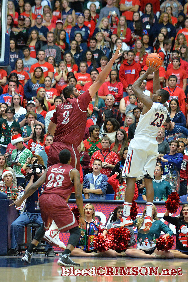 December 11, 2013: New Mexico State Aggies center Sim Bhullar (2) tries to bock a shot attempt from Arizona Wildcats forward Rondae Hollis-Jefferson (23) in a game between No. 1 Arizona and New Mexico State at McKale Center in Tucson, Ariz. Arizona defeated New Mexico State 74-48.