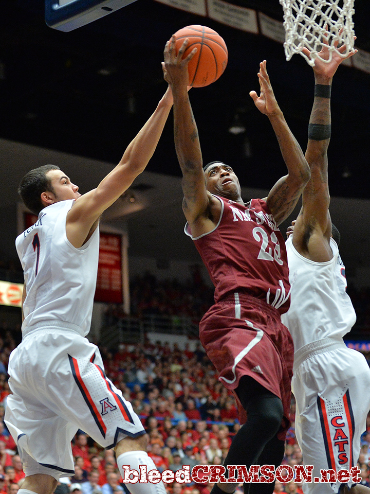 December 11, 2013: New Mexico State Aggies guard Daniel Mullings (23) goes up for a layup in the second half in a game between No. 1 Arizona and New Mexico State at McKale Center in Tucson, Ariz. Arizona defeated New Mexico State 74-48.