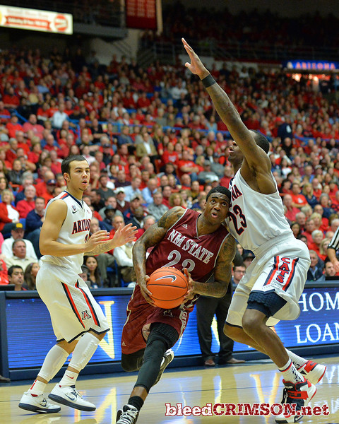 December 11, 2013: New Mexico State Aggies guard Daniel Mullings (23) past Arizona Wildcats forward Rondae Hollis-Jefferson (23) to the basket in a game between No. 1 Arizona and New Mexico State at McKale Center in Tucson, Ariz. Arizona defeated New Mexico State 74-48.