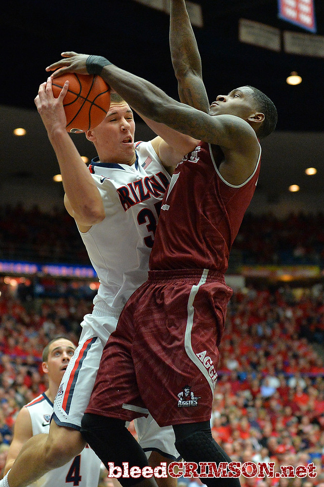 December 11, 2013: New Mexico State Aggies guard DK Eldridge (1) battles Arizona Wildcats center Kaleb Tarczewski (35) for a rebound in a game between No. 1 Arizona and New Mexico State at McKale Center in Tucson, Ariz. Arizona defeated New Mexico State 74-48.