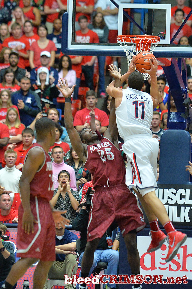 December 11, 2013: Arizona Wildcats forward Aaron Gordon (11) leans in for a shot over New Mexico State Aggies forward Renaldo Dixon (25) in the first half in a game between No. 1 Arizona and New Mexico State at McKale Center in Tucson, Ariz. Arizona defeated New Mexico State 74-48.