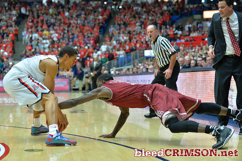 December 11, 2013: New Mexico State Aggies guard DK Eldridge (1) battles for a loose ball in the first half in a game between No. 1 Arizona and New Mexico State at McKale Center in Tucson, Ariz. Arizona defeated New Mexico State 74-48.