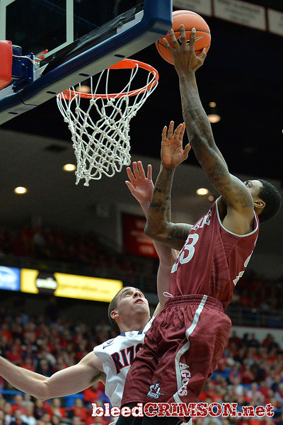 December 11, 2013: New Mexico State Aggies guard Daniel Mullings (23) gets a layup in a game between No. 1 Arizona and New Mexico State at McKale Center in Tucson, Ariz. Arizona defeated New Mexico State 74-48.