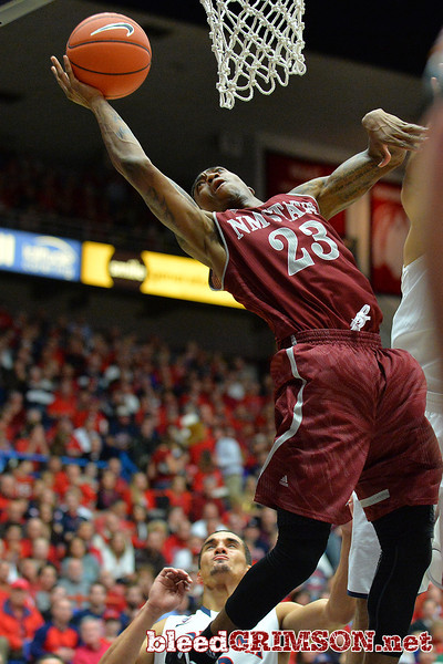 December 11, 2013: New Mexico State Aggies guard Daniel Mullings (23) tries to get a layup in the first half in a game between No. 1 Arizona and New Mexico State at McKale Center in Tucson, Ariz. Arizona defeated New Mexico State 74-48.