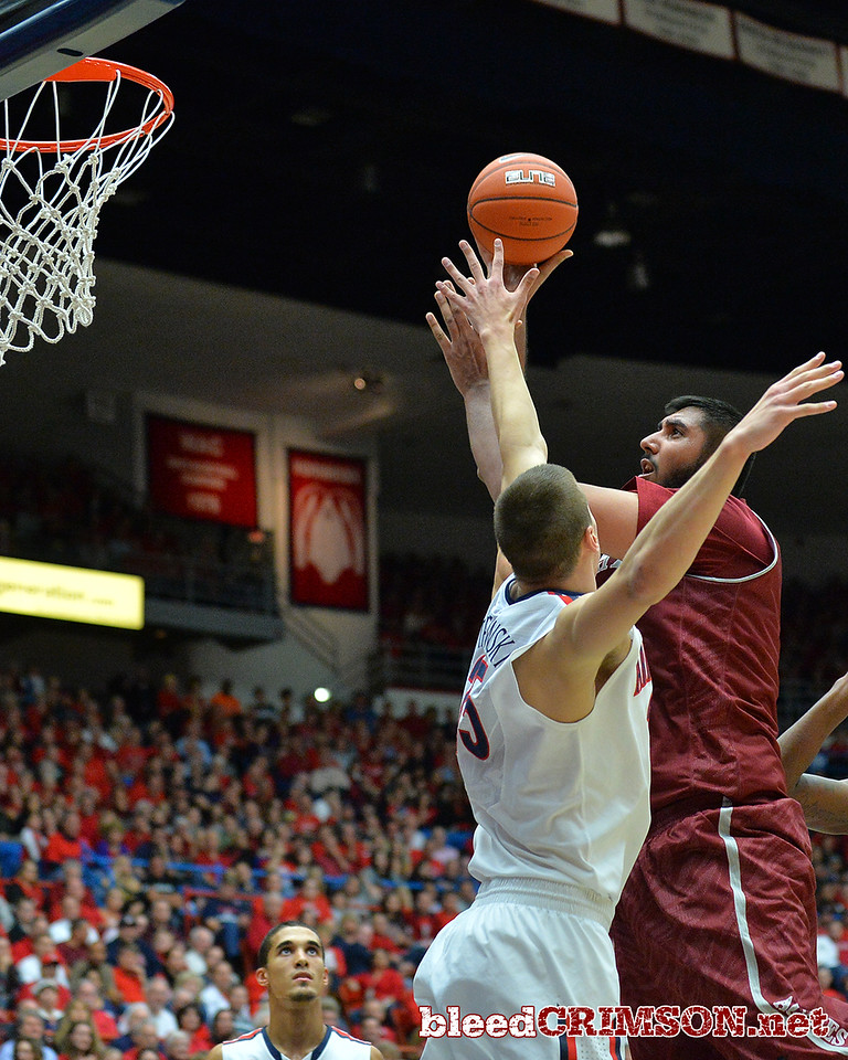 December 11, 2013: New Mexico State Aggies center Sim Bhullar (2) has hit shot contested by Arizona Wildcats center Kaleb Tarczewski (35)in a game between No. 1 Arizona and New Mexico State at McKale Center in Tucson, Ariz. Arizona defeated New Mexico State 74-48.