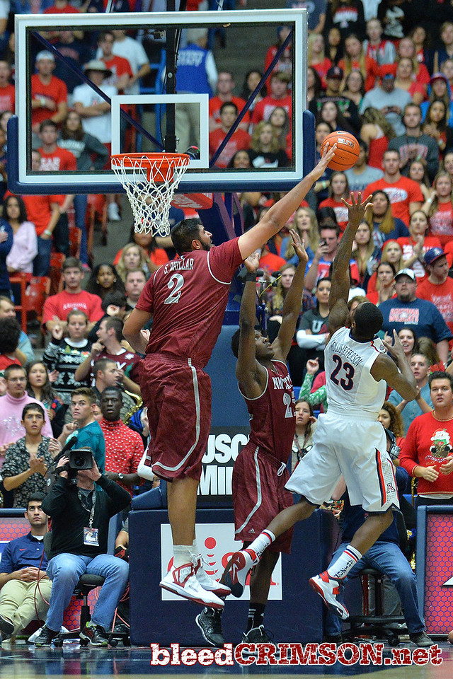 December 11, 2013: New Mexico State Aggies center Sim Bhullar (2) blocks a shot attempt by Arizona Wildcats forward Rondae Hollis-Jefferson (23) in a game between No. 1 Arizona and New Mexico State at McKale Center in Tucson, Ariz. Arizona defeated New Mexico State 74-48.