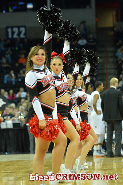 March 20, 2014: Members of the San Diego State Aztecs cheerleading squad during a second round game of the NCAA Division I Men's Basketball Championship between the 4-seed San Diego State Aztecs and the 13-seed New Mexico State Aggies at Spokane Arena in Spokane, Wash. San Diego State defeated New Mexico State 73-69 in overtime.