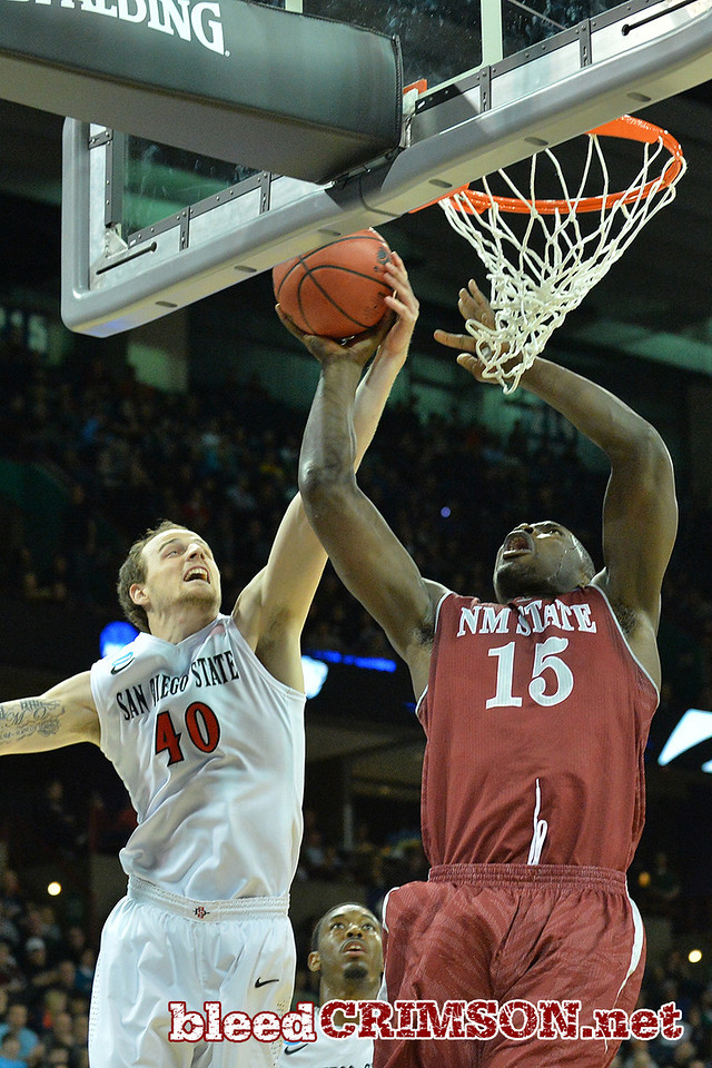 March 20, 2014: San Diego State Aztecs forward Matt Shrigley (40) blocks a shot by New Mexico State Aggies center Tshilidzi Nephawe (15) during a second round game of the NCAA Division I Men's Basketball Championship between the 4-seed San Diego State Aztecs and the 13-seed New Mexico State Aggies at Spokane Arena in Spokane, Wash. San Diego State defeated New Mexico State 73-69 in overtime.