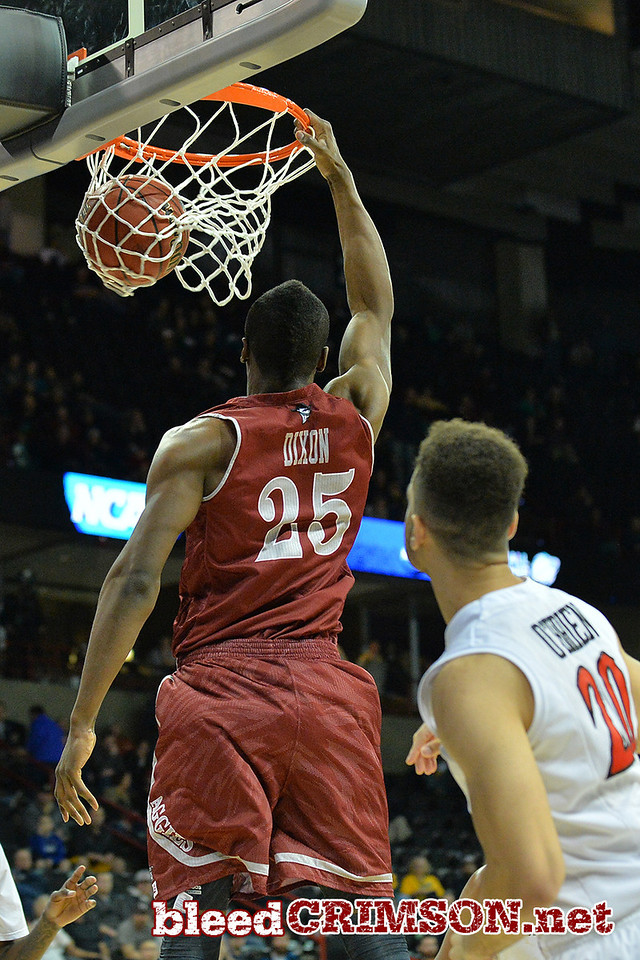 March 20, 2014: New Mexico State Aggies forward Renaldo Dixon (25) dunks during a second round game of the NCAA Division I Men's Basketball Championship between the 4-seed San Diego State Aztecs and the 13-seed New Mexico State Aggies at Spokane Arena in Spokane, Wash. San Diego State defeated New Mexico State 73-69 in overtime.